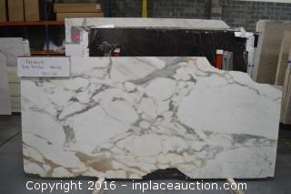 LOT OF (9) SLABS: CERVAIOLE POLISHED, CIPOLLINO HONED, CREMA MARFIL IVORY POLISHED, GAUDI HONED, MARESCO HONED, MINERVA WHITE POLISHED, NERO FOSSIL POLISHED, NEW SAINT LAURENT - POLISHED